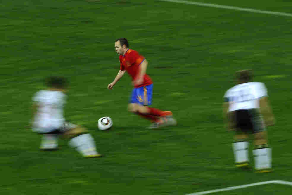 Spain's midfielder Andres Iniesta chases the ball