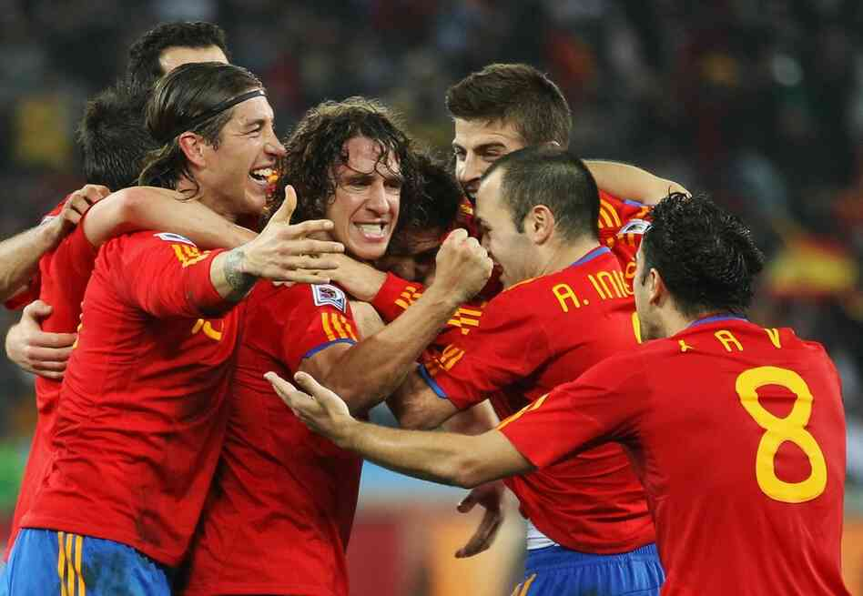 Members of the team from Spain celebrate the opening goal scored by Carles Puyol. Spain beat Germany 1-0.