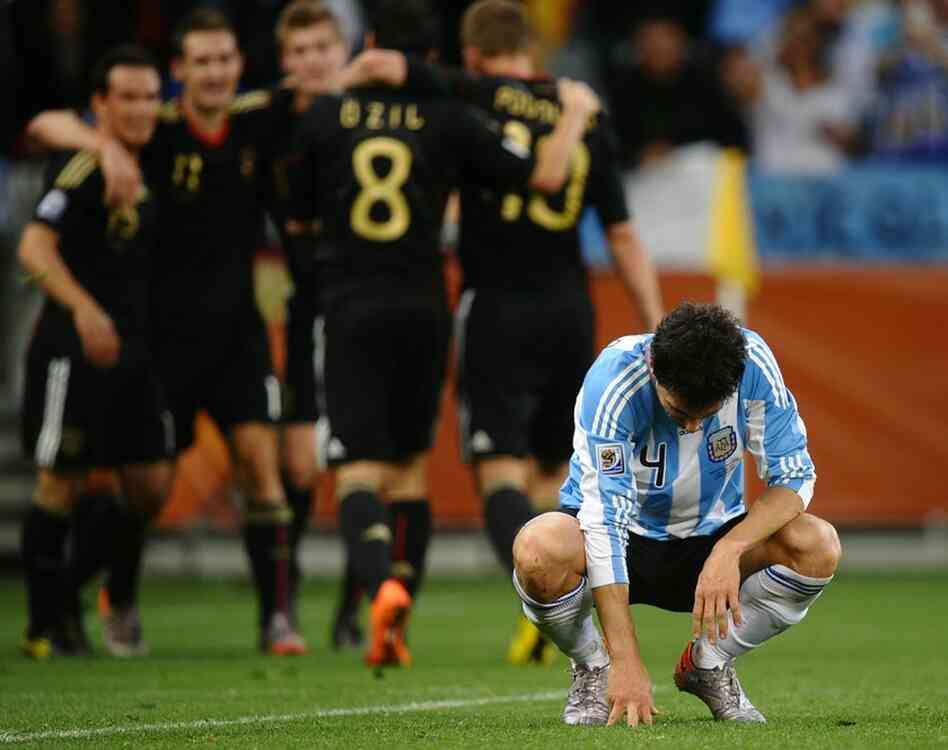 Argentina's defender Nicolas Burdisso (right) reacts with defeat after Germany scored its fourth goal.