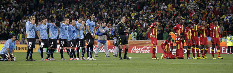 Players for Uruguay (left) and Ghana line up during the penalty shootout. Uruguay reached the World Cup semifinals for the first time since 1970 after beating Ghana 4-2 on penalty shots.
