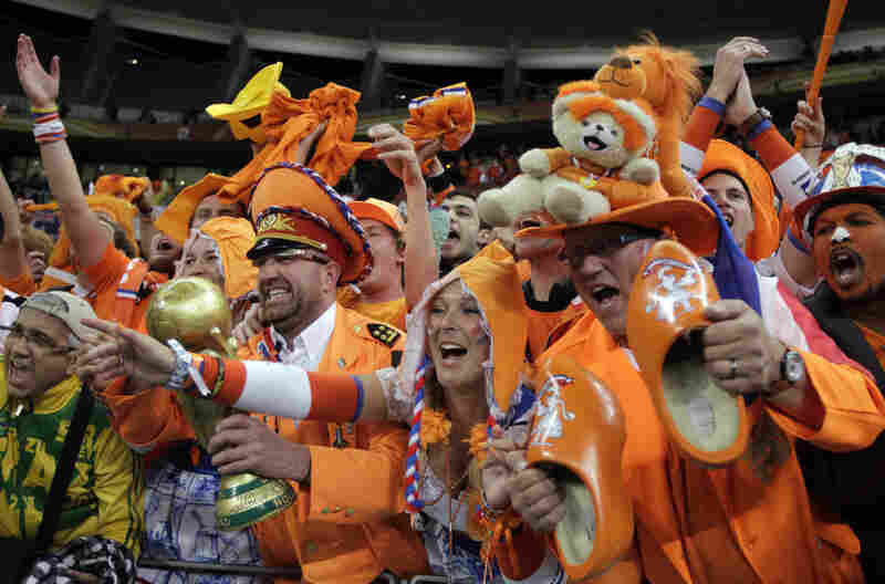 Netherlands supporters celebrate their team's 3-2 win over Uruguay to advance to the finals.