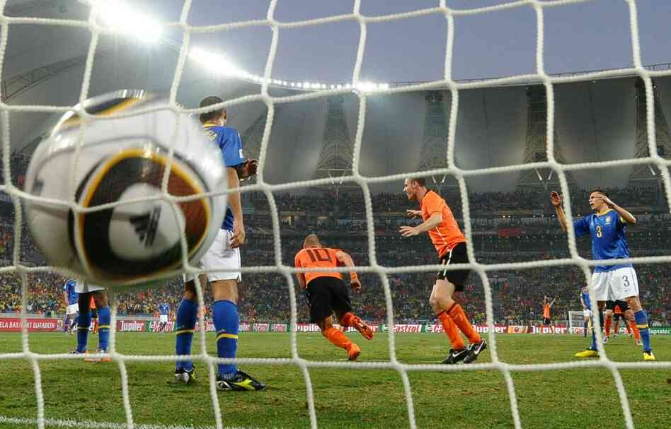 Midfielder Wesley Sneijder (center) scores the Netherlands' second goal during the 2010 World Cup quarterfinal match between the Netherlands and Brazil.