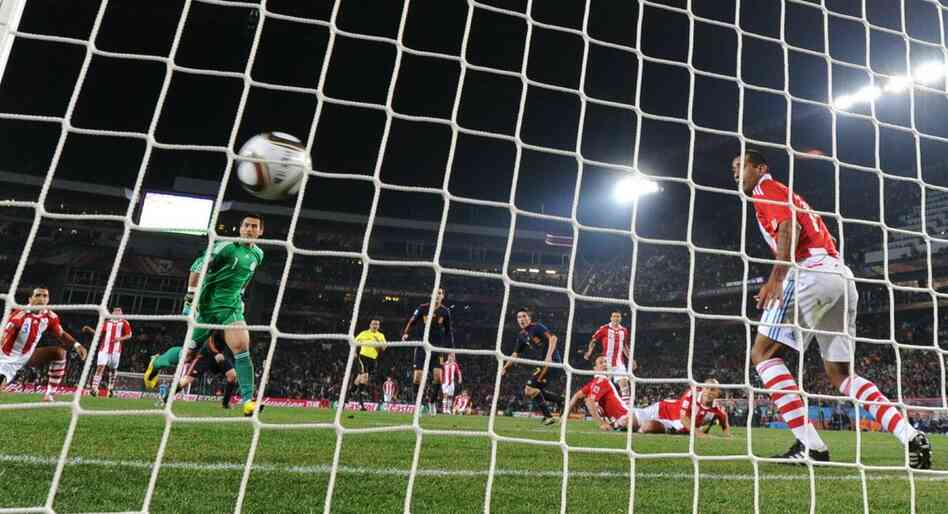 Spain's striker David Villa (fifth from right) scores a goal during the quarterfinal match with Paraguay.