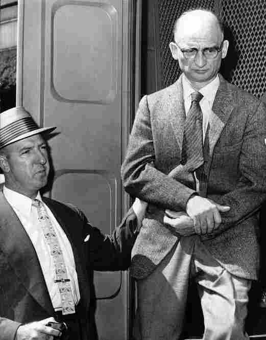 Alleged Russian spy Rudolf Abel (right) steps down from a patrol wagon in front of Brooklyn Federal Court in August 1957. He was due to appear in court on charges of espionage. Abel would later be swapped for Powers.