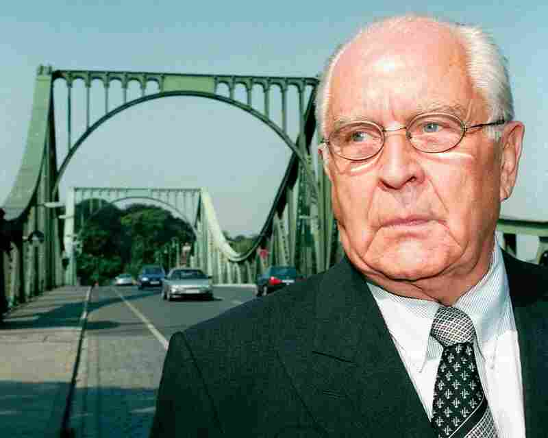 Former East German lawyer Wolfgang Vogel stands in front of the Glienicke Bridge in Berlin, a neutral location where he brokered three of over 150 spy swaps between the U.S. and the Soviet Union.