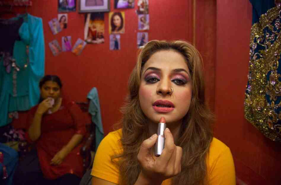"It may seem surprising, but bold lipstick and dancing are the trademarks of Nida Chaudhry, who performs at Lahore's Al Falah theater. ""Whatever we do is the demand of the public,"" she says. ""We ourselves are all Muslims."""
