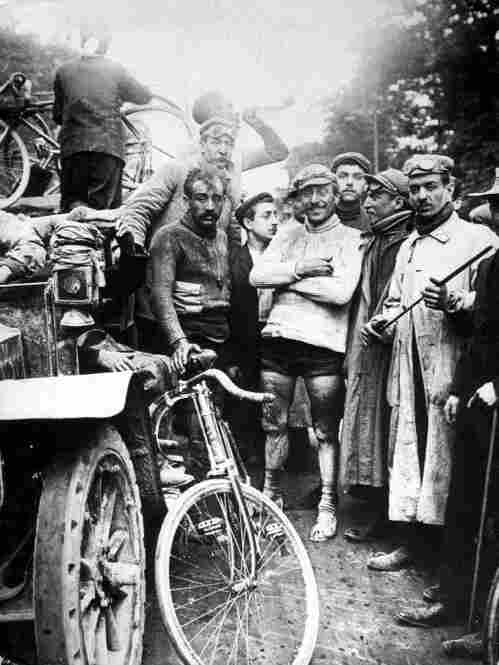 At right is the winner of the first Tour de France, Maurice Garin, in 1903.
