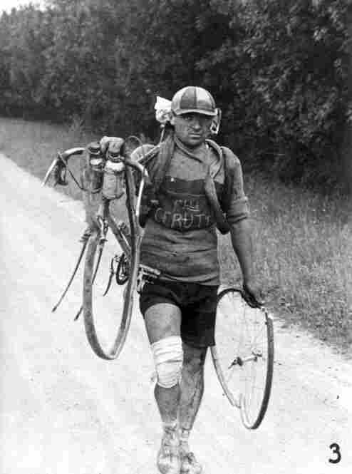 Italian Giusto Cerutti carries his broken bicycle after a fall in 1928. According to the rules he could not accept help.