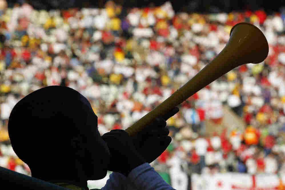Soccer supporter blows a vuvuzela
