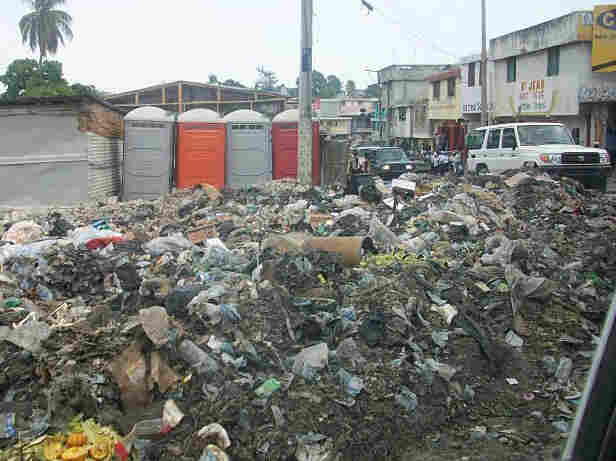 Trash aligns a street in Haiti.