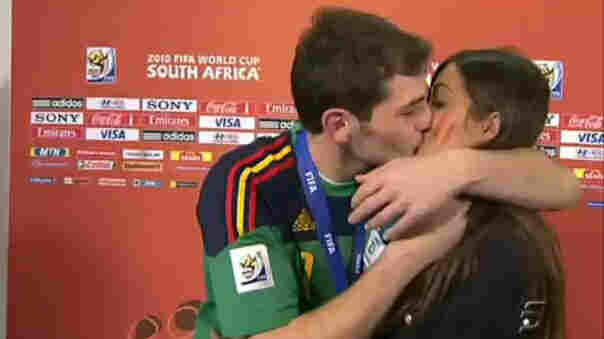 Iker Casillas kisses his girlfriend Sara Carbonero during a live broadcast.