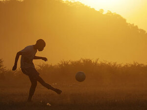 Kids play soccer outside Rustenburg, South Africa