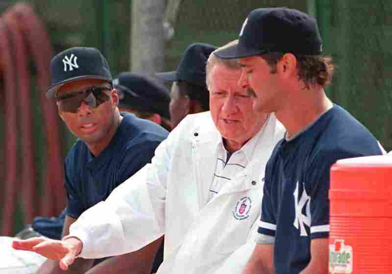 Steinbrenner talks with Don Mattingly (right) as outfielder Bernie Williams looks on during spring training in 1995.
