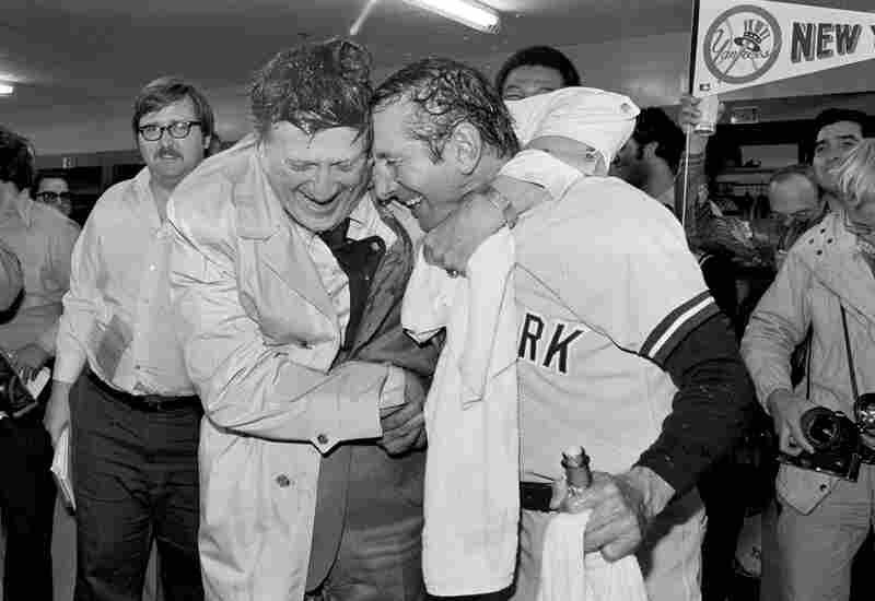 Steinbrenner (left) gives manager Billy Martin a hug after the Yankees won the American League Championship in 1977.