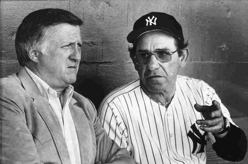 Yankees manager Yogi Berra talks with Steinbrenner in 1984. The two had a notoriously tumultuous relationship.