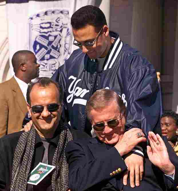 Yankees shortstop Derek Jeter greets manager Joe Torre (left) and Steinbrenner at the start of a rally honoring their 1999 World Series Championship.