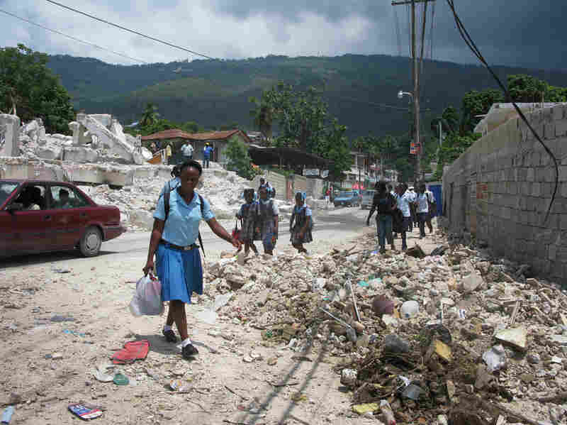 Despite the rubble and lack of permanent housing, a positive sign is the vast number of children who have been able to return to school.