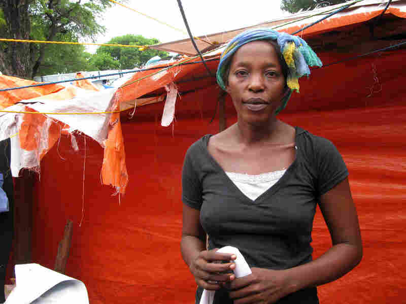 Marie Jules St. Julius lives in a tent in the Petionville Club camp, but she sent her two teenage children to live in the countryside with relatives. She divides her time, spending two weeks at the camp  — where she sells bags of chips, gum, cookies and cigarettes — and two weeks with her children.