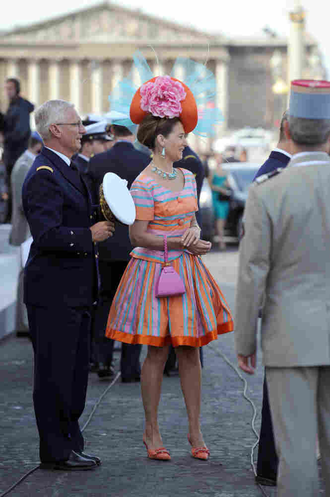 An unidentified woman arrives to attend the annual Bastille Day military parade in Paris.