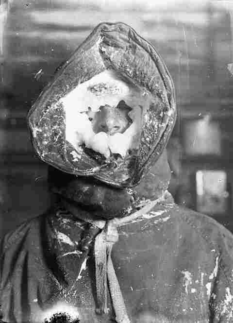 Meteorologist C.T. Madigan covered in ice, 1911-1914.