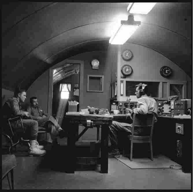 The radio room at McMurdo, housed in a Quonset hut