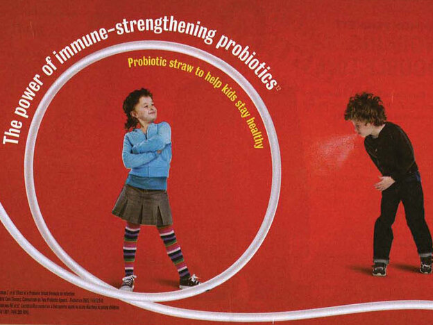 Girl inside straw of Nestle drink: Boost Kid Essentials