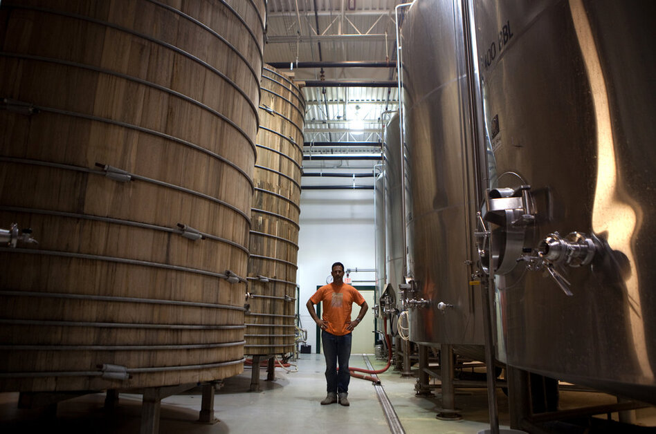 Owner Sam Calagione started Dogfish Head 15 years ago with two 15.5-gallon kegs. Now the brewery has more than a dozen 10,000-gallon tanks.  (NPR/Brad Horn)