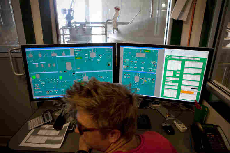 From the control room, brewer Bryan Selders monitors the 7,000 cases of beer Dogfish Head produces each day.