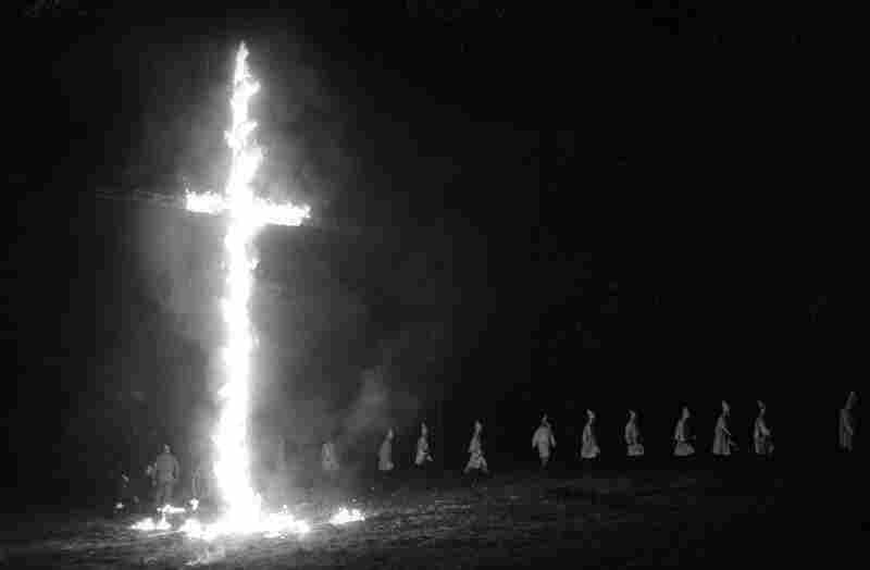 Cross Burning In North Carolina; Photo By Jim WallaceIn the early 1960s, University of North Carolina student Jim Wallace, who was not black, photographed a Ku Klux Klan rally and cross burning to document what he thought was a great evil, museum director Lonnie Bunch says.