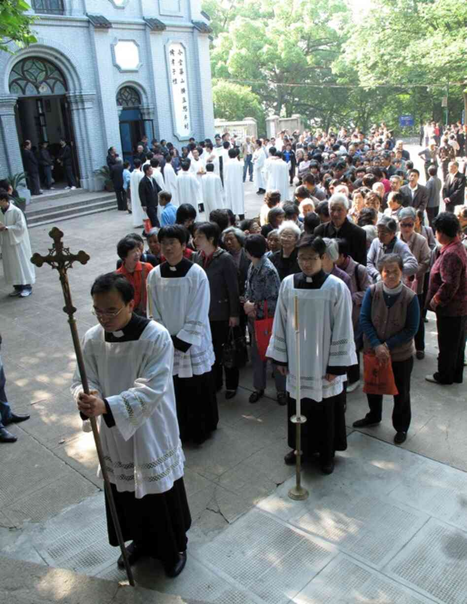 """The procession takes place on May 24, the day that Pope Benedict XVI designated as the international day of prayer for China. But the clergy in China's """"open,"""" or official, church cut ties to the Vatican in 1951."""
