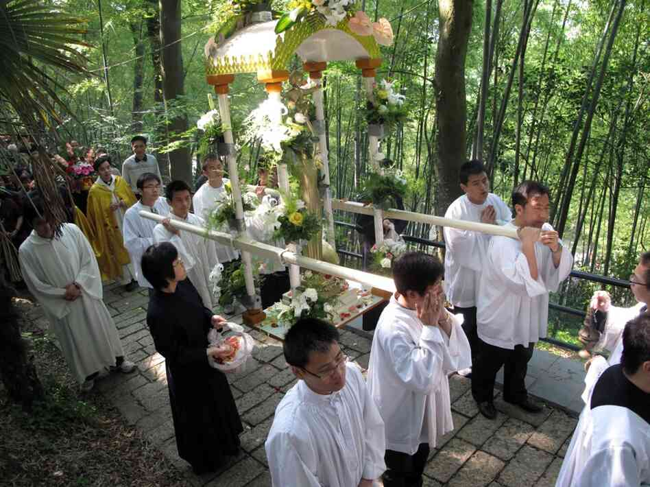 """China's Catholics have traditionally been divided into two churches. One, the """"open"""" or government-sanctioned church, and the """"underground,"""" or Vatican-sanctioned church. Here, clergy from the government-sanctioned church hold a procession to the Sheshan basilica on the outskirts of Shanghai."""