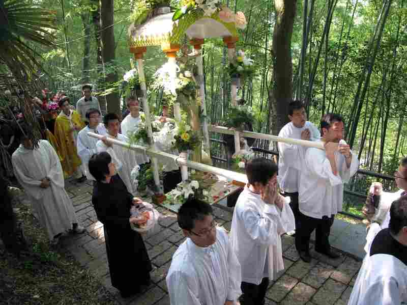 "China's Catholics have traditionally been divided into two churches. One, the ""open"" or government-sanctioned church, and the ""underground,"" or Vatican-sanctioned church. Here, clergy from the government-sanctioned church hold a procession to the Sheshan basilica on the outskirts of Shanghai."