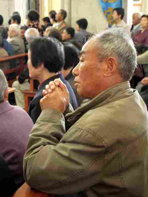 Catholics worship inside the government-sanctioned church on the international day of prayer. For decades, China's more than 12 million Catholics have been bitterly divided.
