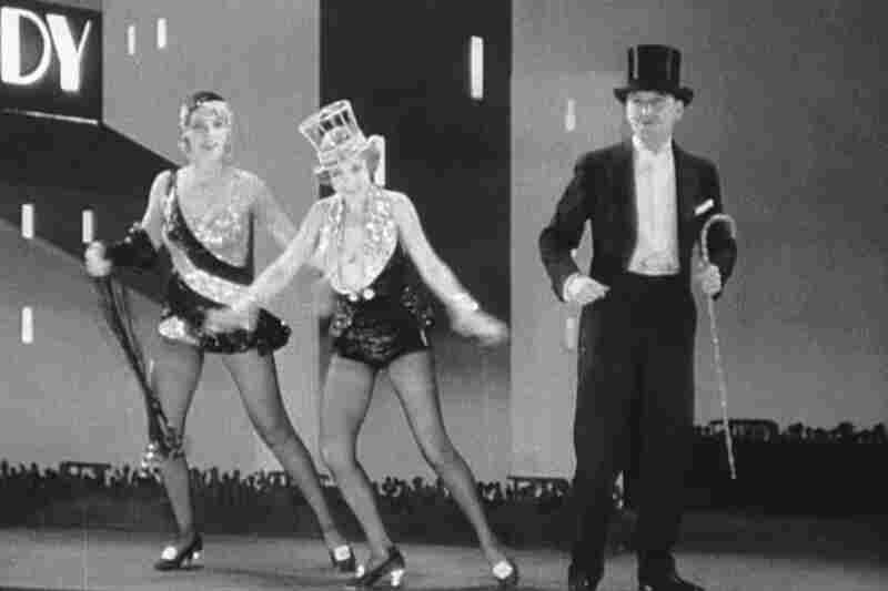 "Anita Page, Bessie Love and Charles King sing ""The Broadway Melody"" in the 1929 film of the same name. It was the first sound film to win the Oscar for Best Picture."