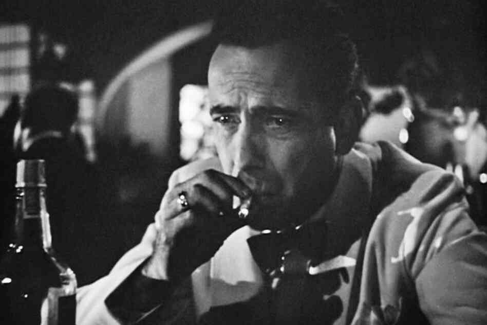 "Humphrey Bogart as Rick Blaine in Casablanca. The song ""As Time Goes By,"" sung by the character Sam (Dooley Wilson), is the No. 2 song on the American Film Institute's (AFI) ""100 Years...100 Songs"" list."