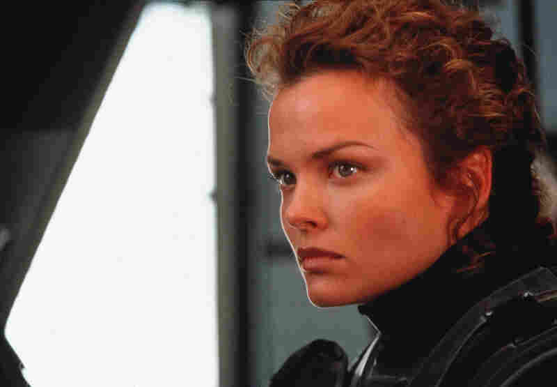 "There are some exceptions: In the world of Starship Troopers, being female is a strength, and not just because it means a hero (Dina Meyer as Dizzy Flores) can tap her maternal instincts when she needs to fight. Women ""make better pilots than men do; their reactions are faster and they can tolerate more [disruption in gravity]. They can get in faster, get out faster, and thereby improve ..."