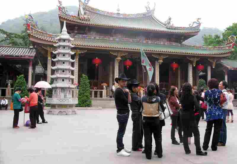 Crowds of tourists visit the ancient Nanputuo Temple in Xiamen, China. Chinese government support for Buddhism is increasing, possibly as a counterweight to the explosion of Christianity. Additionally, local governments get a share of the temple entrance fees.