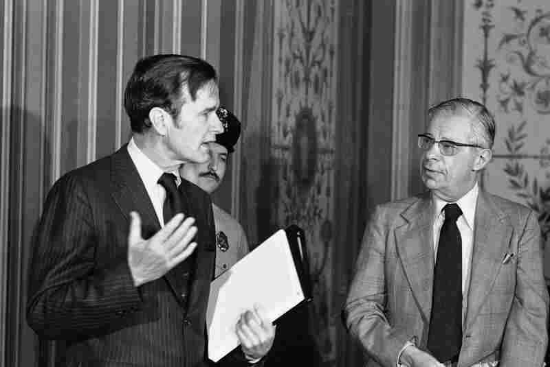 CIA Director George Bush (left) exchanges words with Schorr on Feb. 18, 1976, prior to giving a closed-door briefing to members of the Senate Foreign Relations Committee.