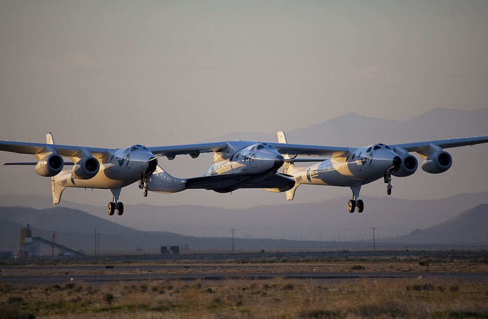 SpaceShipTwo's first captive flight took place in March 2010. It remained attached to WhiteKnightTwo for the duration, but in the future, the spaceship (center) will be launched, fire its rocket and carry passengers into space.  (Virgin Galactic/Mark Greenberg/NPR)