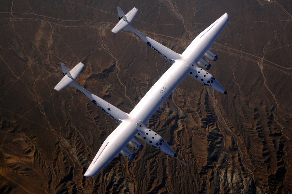 WhiteKnightTwo's is the largest carbon composite plane in the world. Its wingspan is 140 ft and it's able to carry a 35,000-lb payload to an altitude of 50,000 ft.  (Michael Fuchs/NPR)