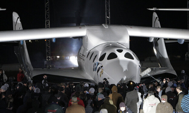 After SpaceShipOne completed the first privately funded spaceflight in 2004, Virgin Galactic partnered with its creator to make SpaceShipTwo — designed to take tourists into space.  (Jae C. Hong/NPR)
