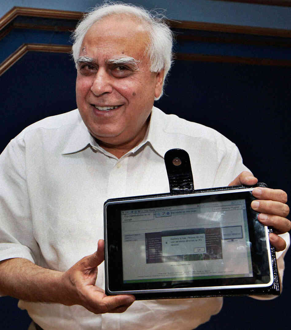 Kapil Sibal, India's human resource development minister, displays India's low-cost tablet prototype