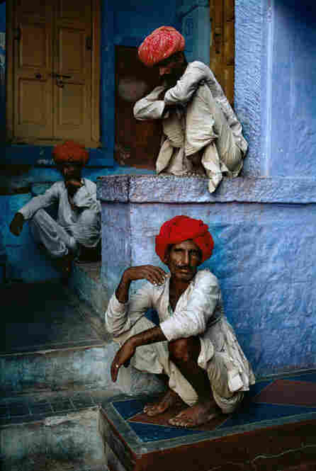 Three men sit in the old quarter in Jodhpur, India, 1996