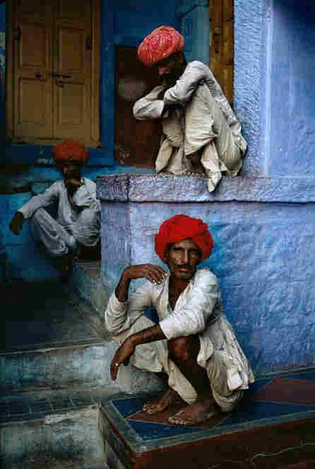Three men sit in the old quarter in Jodhpur, India, 1996