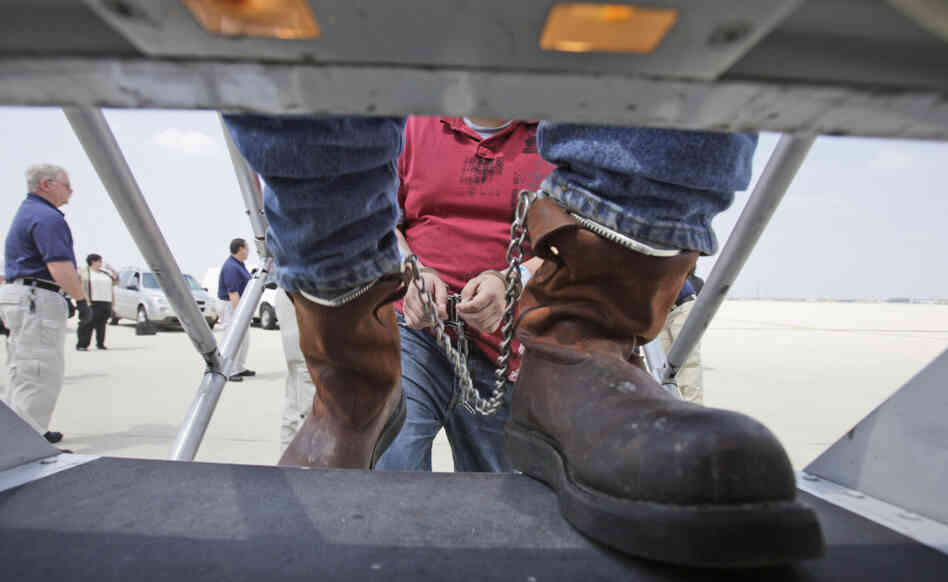 deportees in shackles