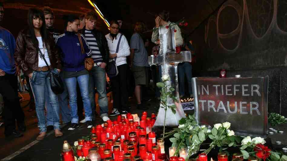 Mourners at the Love Parade site in Duisburg, Germany