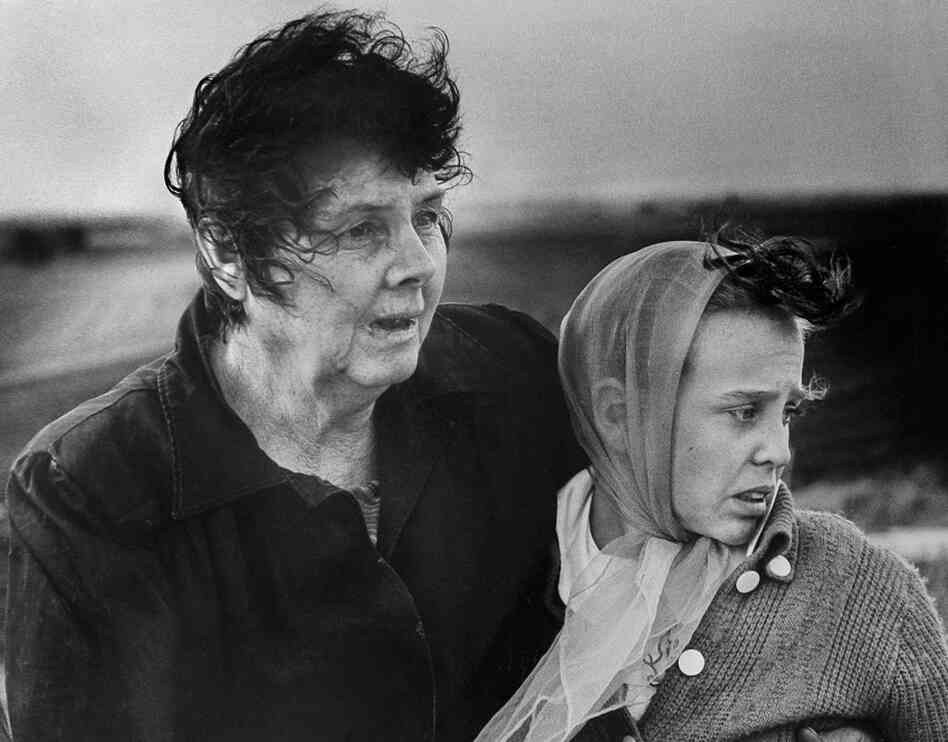 A mother and daughter survey the wreckage of their home after the historic June 8, 1966, tornado.