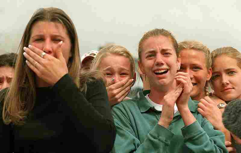 Columbine High School students react to the news that some of their friends had survived the shooting carnage that claimed 15 lives near Littleton, Colo., on April 20, 1999.