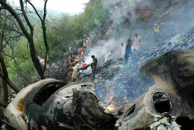 Pakistani rescue workers search the wreckage of a crashed passenger plane in the Margalla Hills on the outskirts of Islamabad on Wednesday. All 152 people on board were killed.