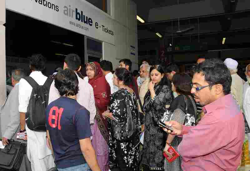 Family members gather at the Airblue counter in Islamabad to try to get details about their relatives.